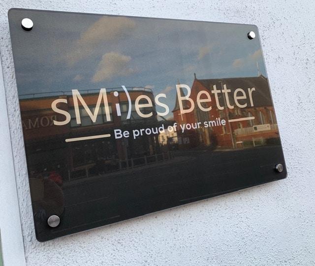 smiles-better-sign